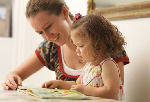 Mother reading to daughter